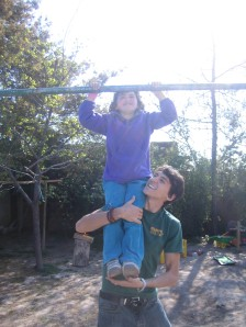 Pull-ups with one of the kids in Mi Club Domingo Savio